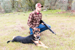 Man Hunting With Dog Stock Images