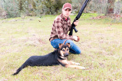 Man Hunting With Dog Royalty Free Stock Photography