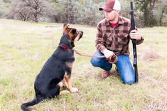 Man Hunting With Dog Royalty Free Stock Image