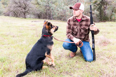 Man Hunting With Dog Stock Photo