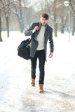 Man is hurry walking. Man in hurry walking on road at the winter snowy park Stock Photography