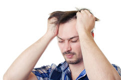 The man is hurt by the head. The adult man in a shirt holds hands the sore head Stock Photo