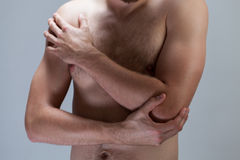 Man with hurting elbow Stock Photo