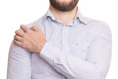 A man hurts his shoulder. On white background isolation royalty free stock photography