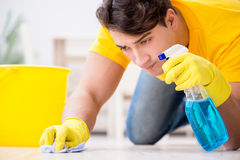 The man husband cleaning the house helping his wife. Man husband cleaning the house helping his wife Stock Images