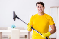 The man husband cleaning the house helping his wife Royalty Free Stock Photo