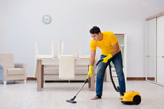 The man husband cleaning the house helping his wife Royalty Free Stock Photography