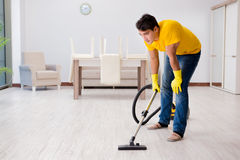 The man husband cleaning the house helping his wife Stock Photo