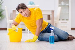 The man husband cleaning the house helping his wife Stock Photography