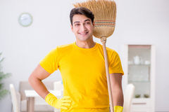 The man husband cleaning the house helping his wife Stock Images