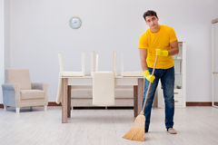 The man husband cleaning the house helping his wife Royalty Free Stock Image