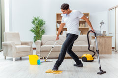 The man husband cleaning the house helping wife Stock Photography