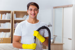 The man husband cleaning the house helping wife Stock Image