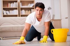 The man husband cleaning the house helping wife Royalty Free Stock Images