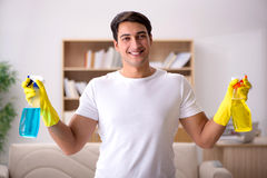 The man husband cleaning the house helping wife Royalty Free Stock Image