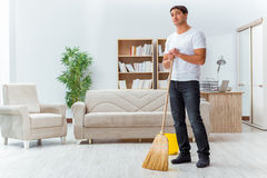 The man husband cleaning the house helping wife Stock Images