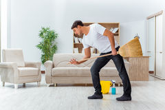 The man husband cleaning the house helping wife Stock Photos