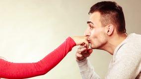 Man husband kissing woman hand. Love couple. Royalty Free Stock Photos