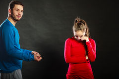 Man husband talking to offended woman wife. Stock Photo