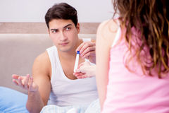 The man husband upset about pregnancy test results Stock Images