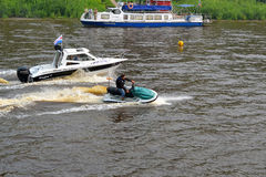The man on a hydrocycle floats down the river. Stock Image