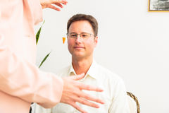 Man Hypnotized By Therapist Royalty Free Stock Photo