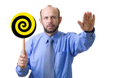 Man hypnotizing you. Hypnosis, focused on hand with spiral, but face is readable Royalty Free Stock Image