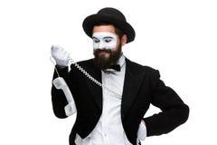 Man i bildfaderns som rymmer en telefonlur Royaltyfri Foto