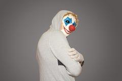 Man i den onda clownen för maskering Arkivfoton