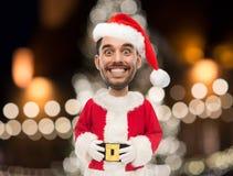 Man i den Santa Claus dräkten över julljus Royaltyfri Foto