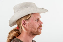 Man i den vita hatten Arkivbild
