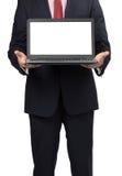 Man i dräkt med bärbara datorn Arkivfoto