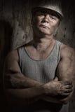 Man i en hjälmgruvarbetare Fotografering för Bildbyråer