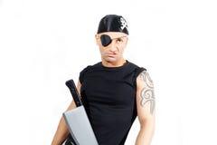 Man i en piratkopieradräkt Fotografering för Bildbyråer