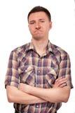 Man i en plädskjorta med roliga framsidauttryck royaltyfri foto