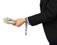 Man i en svart dräkt med dollar och ett kort i händerna med mummel royaltyfria foton
