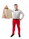 Man i hållande shoppingpåsar för elegant klänning Arkivfoto