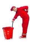 Man i röda overaller Fotografering för Bildbyråer