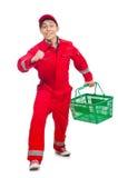 Man i röda overaller Arkivbild