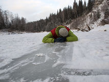 Man on the ice. Man sleep on the ice (winter river Stock Images