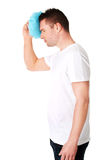 Man with ice bag for headaches Royalty Free Stock Images
