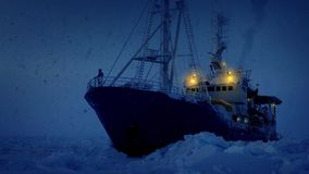 Man On Ice Breaker Ship In Snowstorm stock video footage