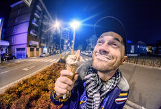 Man with ice cream at night in the city Stock Image