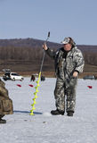 The man on the ice fishing Stock Photography