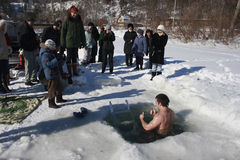 Man in the ice-hole Stock Image