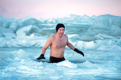 Man in an ice-hole Stock Images