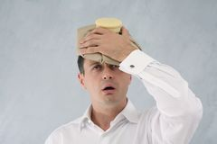 Man with ice pack. On head in great pain Royalty Free Stock Images