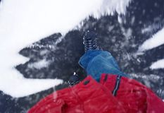 A man on a ice skates is riding on ice, pov royalty free stock photos
