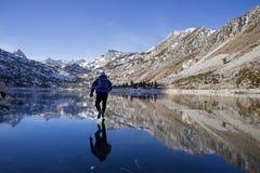 Man Ice Skating On Mountain Lake Royalty Free Stock Images