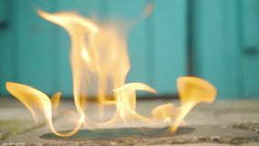Man ignite gasoline on the ground using the lighter in slowmo.  stock video
